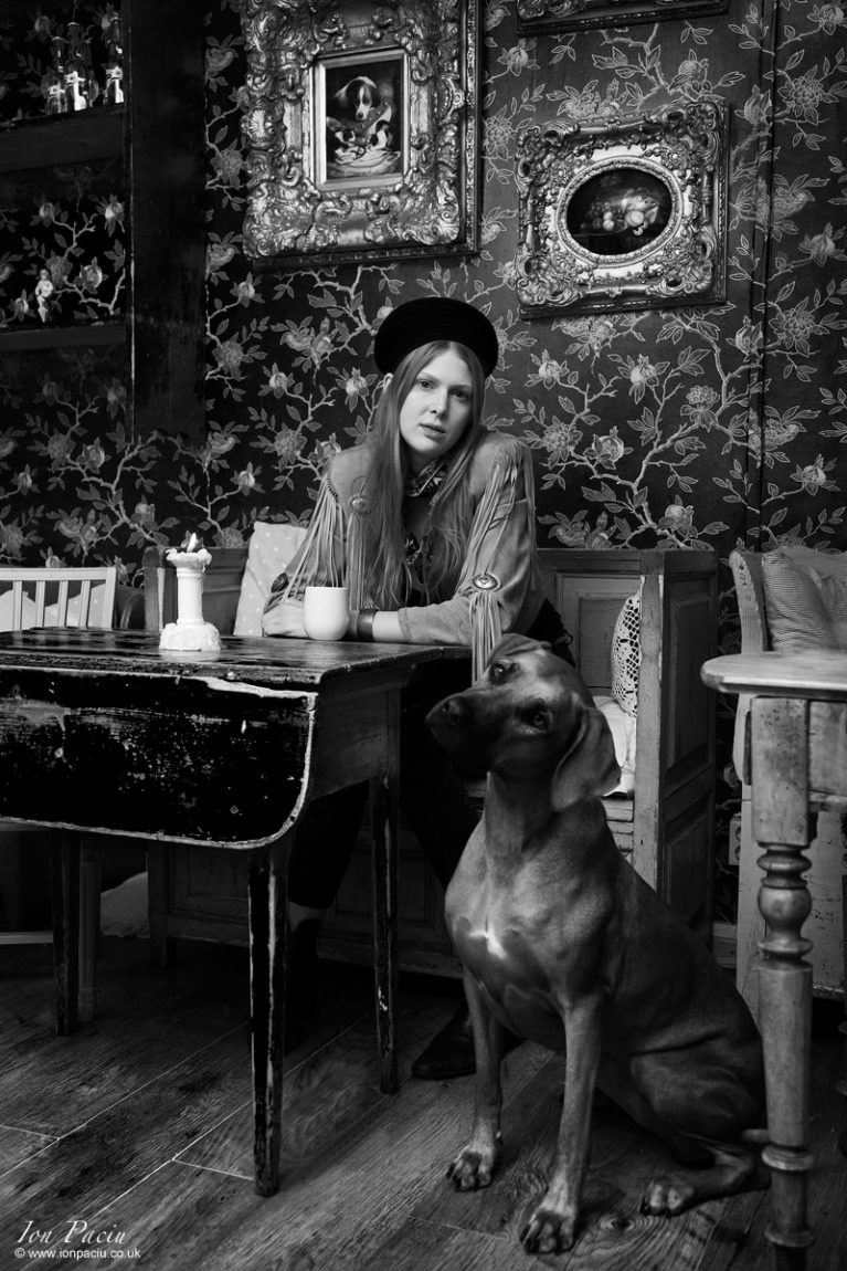 Photo of a women and her dog in le petit cafe in Sweden